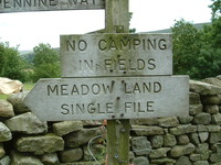 A sign saying 'No Camping in t' Fields'