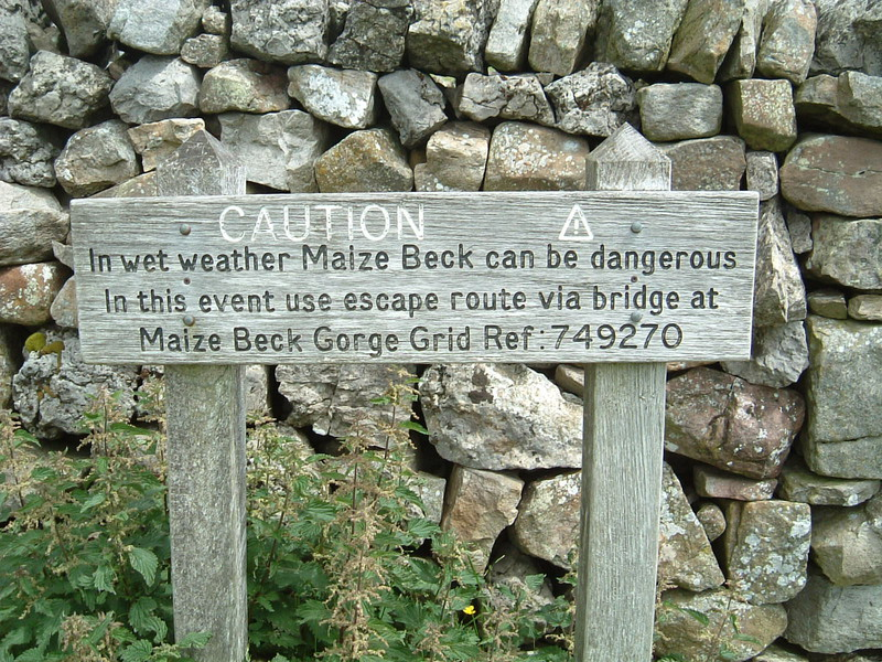 A sign warning that Maize Beck can flood