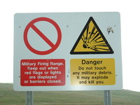 A sign warning of a military firing range