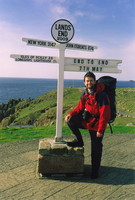 Mark posing by the Land's End signpost before setting off for John o'Groats