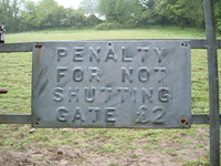 A sign saying 'Penalty for not shutting gate £2'