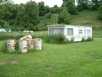 A not-so-posh static caravan gently mouldering by the River Severn