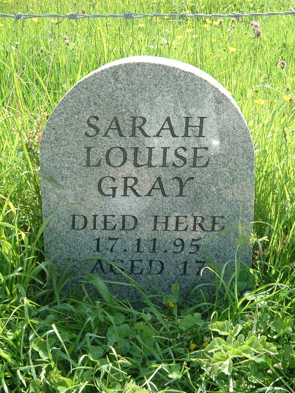 A memorial saying 'Sarah Louise Gray Died Here 17.11.95 Aged 17'